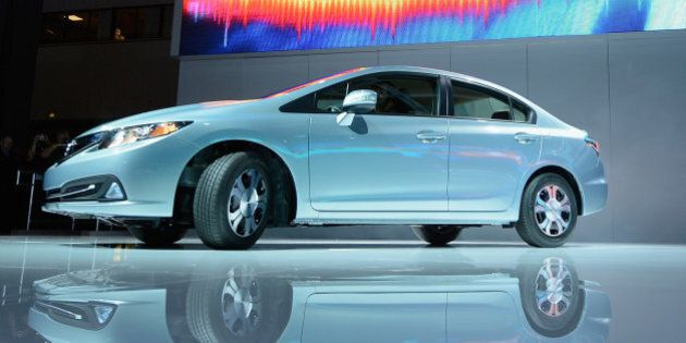 LOS ANGELES, CA - NOVEMBER 29: A new 2013 Honda Civic Hybrid is unveiled during the Los Angeles Auto...
