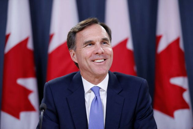 Bill Morneau takes part in a news conference in Ottawa on July 18,