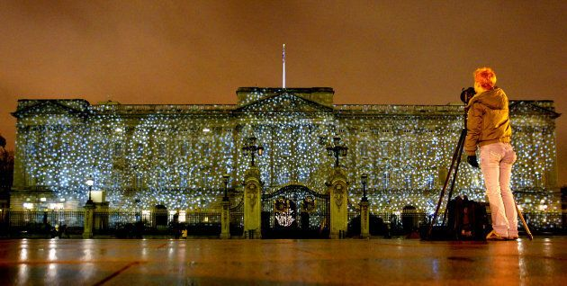 Falling snowflakes is projected onto Buckingham Palace.