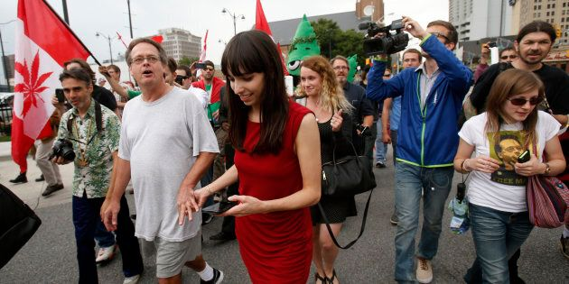 Marijuana advocate Marc Emery (2nd L) and his wife Jodie (3rd L) walk down a street followed by his supporters...