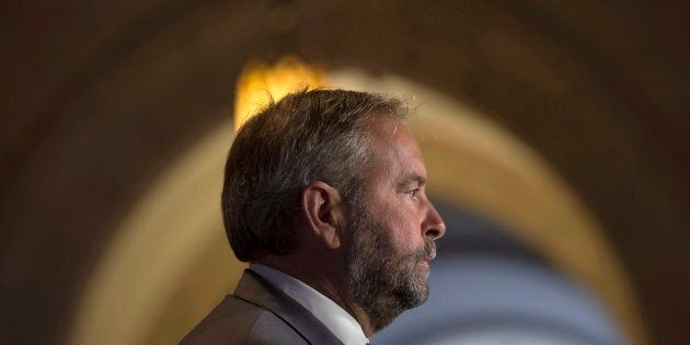 NDP leader Tom Mulcair speaks to media after the NDP held their weekly caucus meeting in Ottawa on Sept....