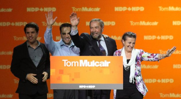 Tom Mulcair waves with his wife Catherine and sons Greg and Matthew after he gave his concession speech...