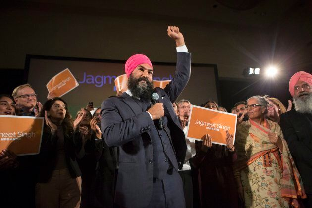 Jagmeet Singh celebrates with supporters after winning the first ballot in the NDP leadership race to...