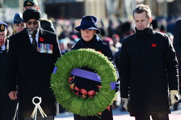 Defence Minister Harit Sajjan, Sophie Gregoire Trudeau and Veterans Affairs Minister Seamus O'Regan place...