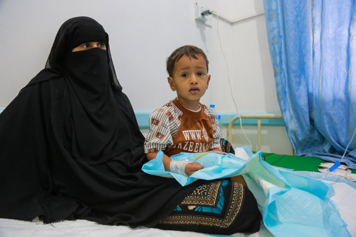 A mother sits with her child, who is being treated for malnutrition, during a visit by UNICEF Executive Director Anthony Lake to the Alsabeen Hospital in Sanaa, Yemen, on July 25, 2017.