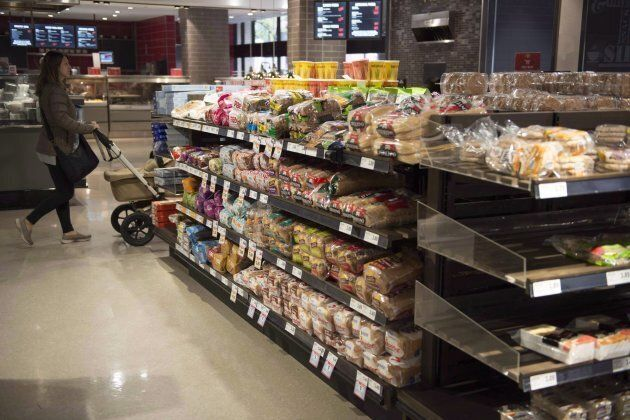 Various brands of bread sit on shelves in a grocery store in Toronto on Nov. 1,