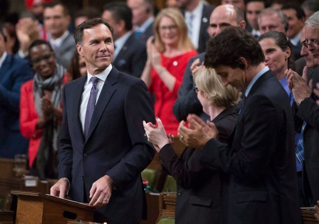Finance Minister Bill Morneau is given a standing ovation as he presents the fall fiscal update in the...