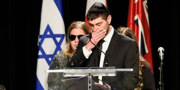 Jonathon Sherman cries as he speaks during a memorial service for his parents Barry and Honey Sherman,...