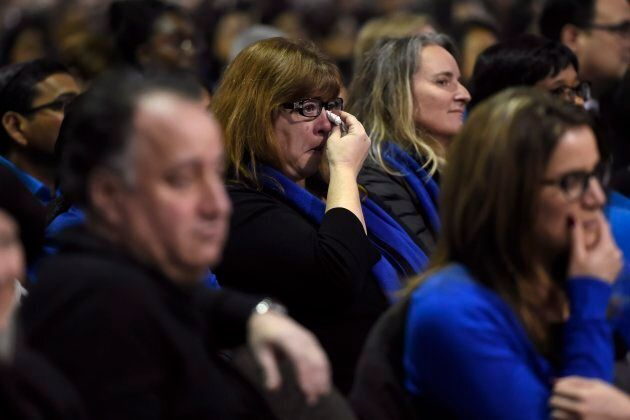 A woman cries in the employees section during a memorial service for Apotex billionaire couple Barry...