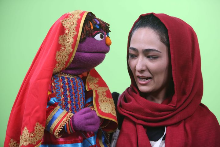 Afghan puppeteer Mansoora Shirzad, right, with Sesame Street's new character, a 6-year-old Afghan girl called Zari, in Kabul, Afghanistan.