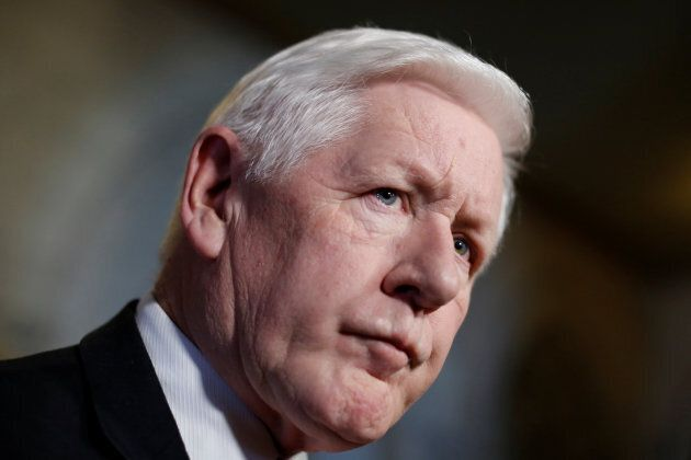 Canada's special envoy to Myanmar Bob Rae listens to a question during a news conference on Parliament...