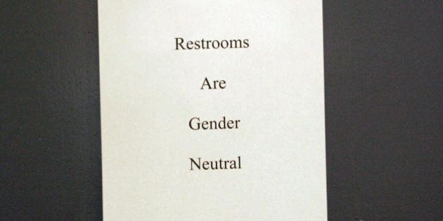 West Hollywood, UNITED STATES: A sign is posted at the entrance of the restrooms during the 'Transgender...