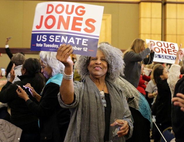 Supporters of Democratic Alabama U.S. Senate candidate Doug Jones celebrate at the election night party...