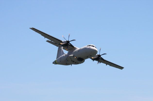 An ATR42 of the Italian financial police perform at the Rome International Air Show on June 3,