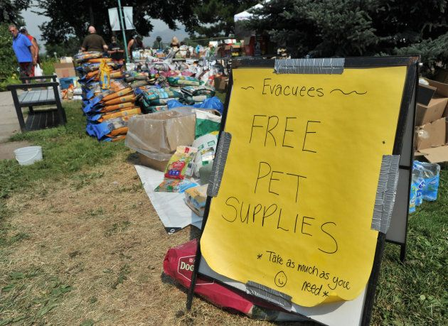Volunteers help pet owners evacuated from Kamloops with food for their pets on July 19,