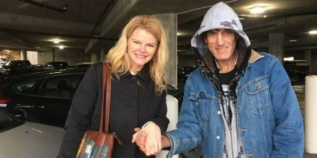 Trinda Gajek, left, and Raymond Ahlstrom pose after the return of her lost ring in Nanaimo, B.C., in...
