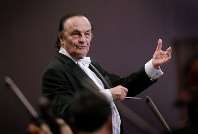 Swiss conductor Charles Dutoit directs the Royal Philharmonic Orchestra at Grand Palace Concert Hall...
