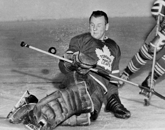 Toronto goalie Johnny Bower misses the puck. Bower continued to be involved with the Leafs organization...