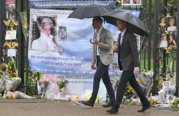 Prince William and Prince Harry view tributes to their mother Princess Diana following a visit to The White Garden in Kensington Palace.