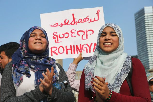 Muslim girls chant slogans of support for the Rohingya Muslims as hundreds of demonstrators marched to...