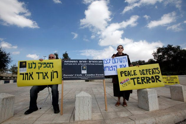 Israelis hold signs supporting a prisoner exchange deal with Hamas, outside Israel's Supreme Court in...
