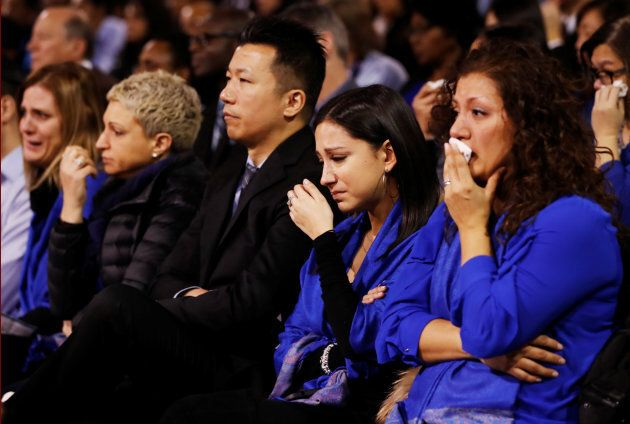 A woman cries during a memorial service for Apotex pharmaceutical billionaire Barry Sherman and his wife...