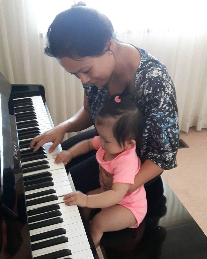 My daughter and I playing piano.