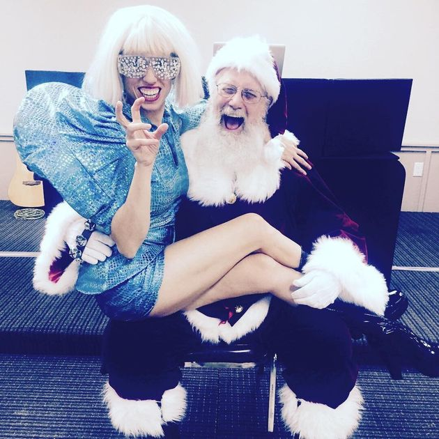The author posing with Santa at a corporate Christmas party in