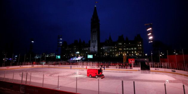 A Zamboni driver cleans the ice on the Canada 150 rink on the front lawn of Parliament Hill Dec. 7,