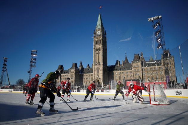 Members of Parliament and senators take part in a friendly game of hockey against journalists (green...