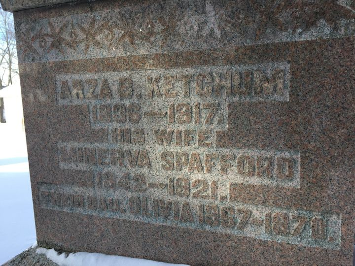 The gravestone of the house's first inhabitants, Azra Ketchum and Minerva Spafford, and their daughter Olivia.