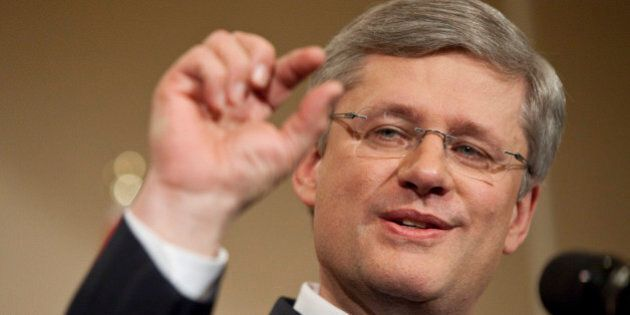 Canadian Prime Minister Stephen Harper speaks to the media at a press conference in Calgary, Alberta,...