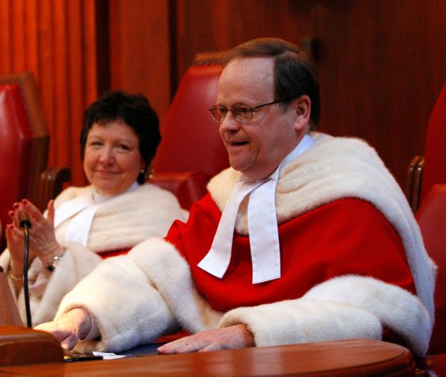 Supreme Court of Canada Justice Thomas Cromwell is applauded by Justice Louise Charron during a ceremony...