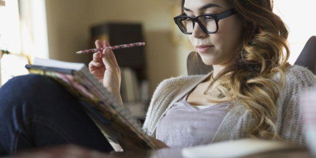 Woman writing in