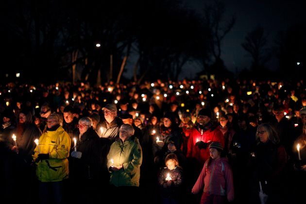 Hundreds of people hold candles in support and memory of Aubrey Berry, 4, and her sister Chloe, 6, during...