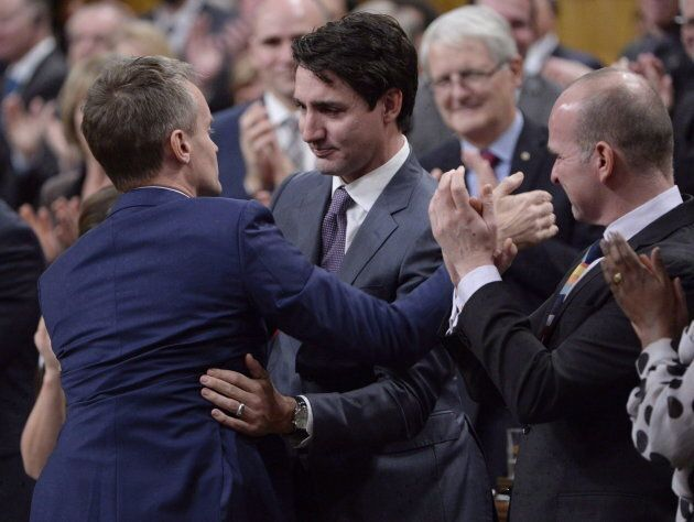 Prime Minister Justin Trudeau hugs Veterans Affairs Minister Seamus O'Regan after making a formal apology...
