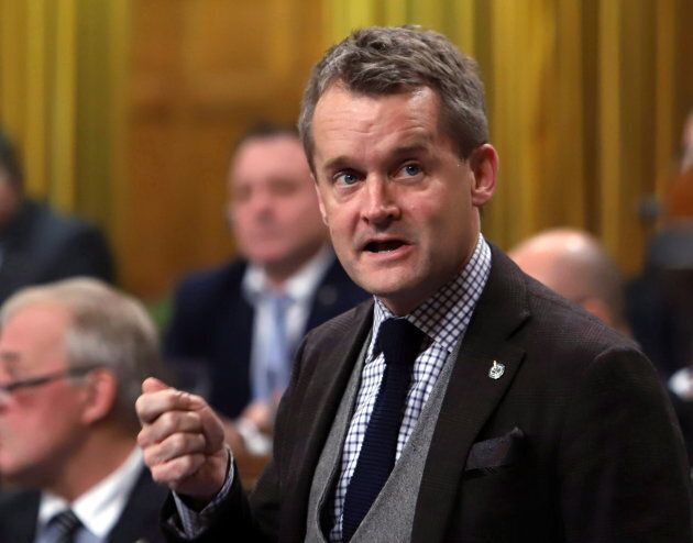 Veterans Affairs Minister Seamus O'Regan stands during Question Period in the House of Commons on Dec....