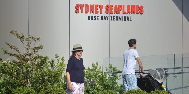 Visitors are seen at the entrance to the Sydney Seaplanes terminal in Rose Bay, Sydney on Jan. 1,