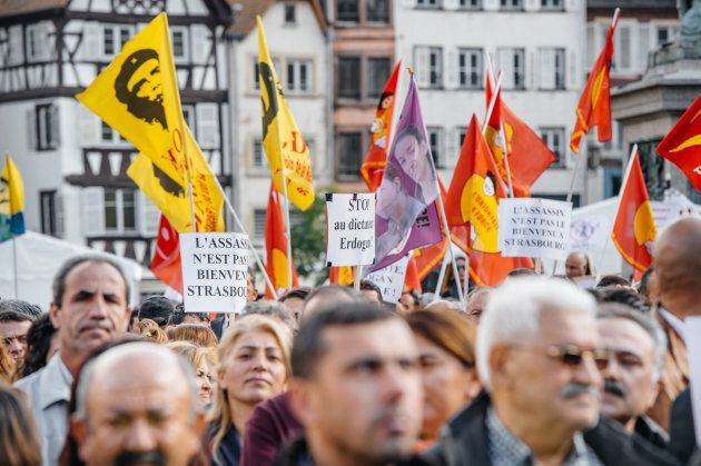 Demonstrators protesting against Turkish President Recep Tayyip Erdogan's visit to Strasbourg, France,...
