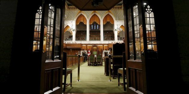 Pages and staff prepare the House of Commons on Parliament Hill on Dec. 2,