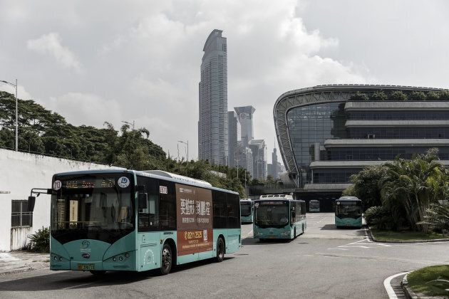 BYD Co. electric buses drive out of a public transportation hub in Shenzhen, China, on Sept. 20, 2017.