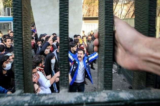In this Saturday, Dec. 30, 2017 photo, by an individual not employed by the Associated Press and obtained by the AP outside Iran, university students attend an anti-government protest inside Tehran University, in Tehran.