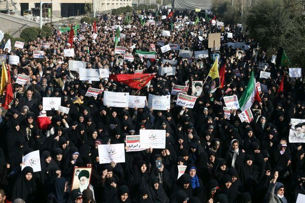 In this Dec. 30, 2017, photo, Iranian protesters chant slogans at a rally in