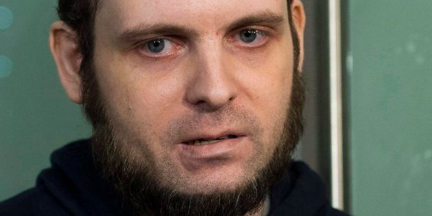 Joshua Boyle speaks to the media after arriving at the airport in Toronto on Oct. 13,