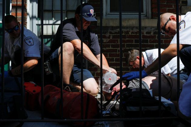 Medics and EMTs, along with firefighters, revive a man found unresponsive after overdosing on an opioid in the Boston suburb of Salem, Massachusetts, on Aug. 9, 2017.