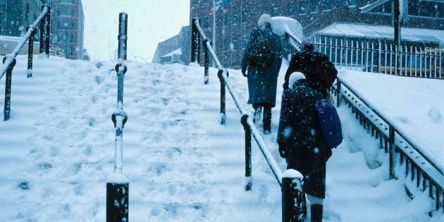 People walking up snowy steps , Nova Scotia ,