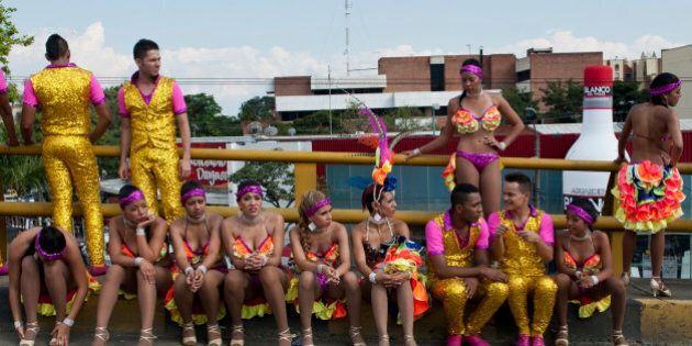Salsa dancers wait for the start of the Salsodrome parade, on December 25, 2013, in Cali, Colombia, where...