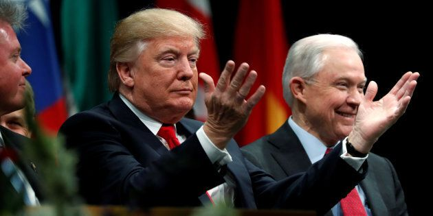 U.S. President Donald Trump is seated with Attorney-General Jeff Sessions at the FBI Academy in Quantico, Virginia, U.S. Dec. 15, 2017. Sessions is reportedly planning to rescind a marijuana-friendly policy from the Obama era.