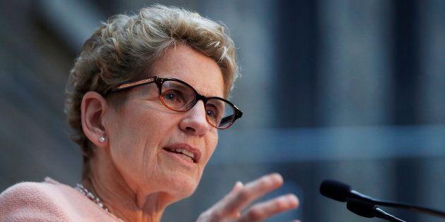 Ontario Premier Kathleen Wynne speaks in Toronto on Dec. 12,