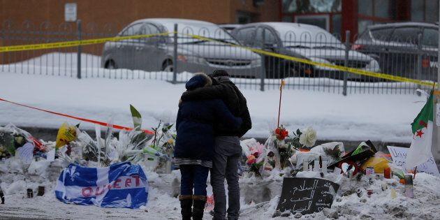 Azzedine Najd (R) and his wife Fadwa Achmaoui look at the memorial near the site of a fatal shooting...